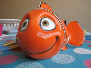 Look, here's Nemo...we found him...he was at Elsie's all the time! Fish money bank £20