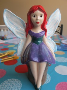 Our sitting fairy, busy watching the world go buy £19.50