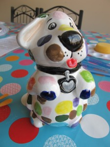 Woof woof! Give us a snausage and I'll look after your pennies! Puppy money bank £18