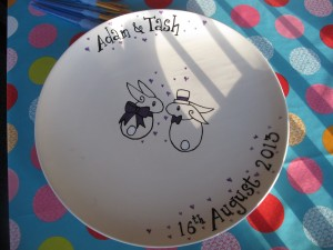 This was a wedding plate for my very special friends. At the wedding the guests all signed the plate...such a special keepsake of a special day. These are painted on commission, prices start from £40
